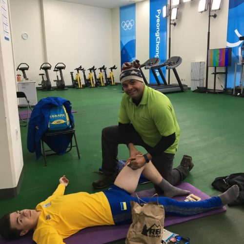 Amit treating Olympic Figure Skater,Yarik with iASTM and cupping in the warm up area for athletes at the Gangneung Ice Arena in South Korea.
